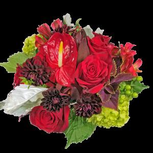 Short Compact Rose arrangement with interesting accompaniments.